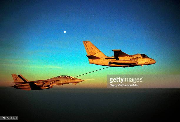 An F14A Tomcat fighter aircraft refueling from an S3B Viking during flight operations from aboard the aircraft carrier USS Enterprise Enterprise is...