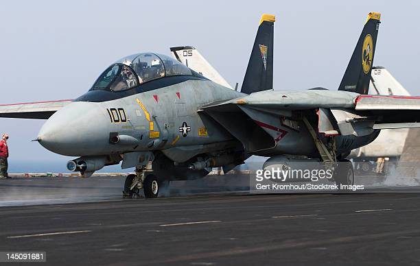 An F-14D Tomcat launches off the flight deck of USS Theodore Roosevelt.