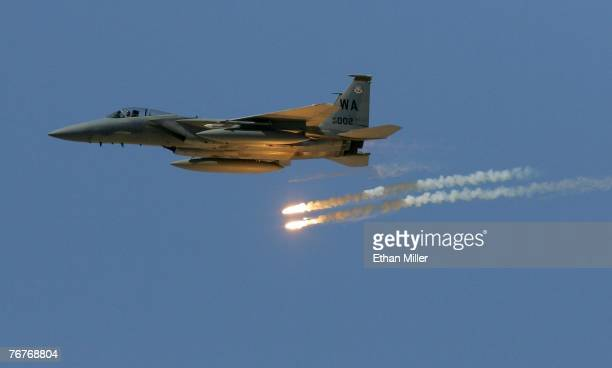 An F15 Eagle drops flares during a US Air Force firepower demonstration at the Nevada Test and Training Range September 14 2007 near Indian Springs...