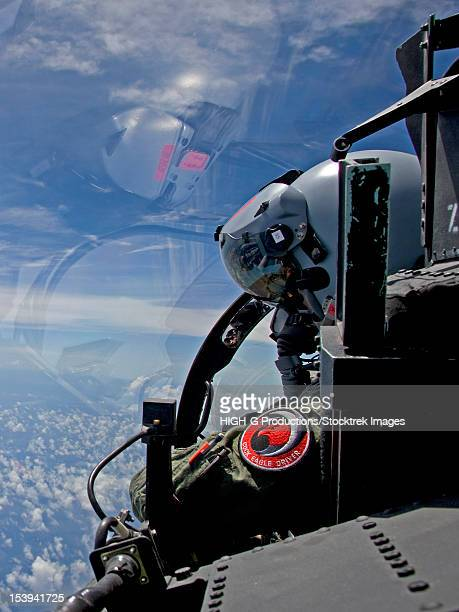 an f-15 eagle pilot flies in formation with his wingman. - head mounted display stock photos and pictures