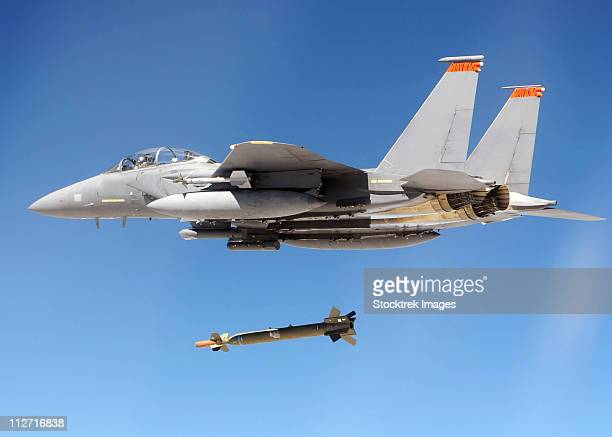 an f-15e strike eagle drops a gbu-28 bomb during a combat hammer mission. - bombing stock pictures, royalty-free photos & images