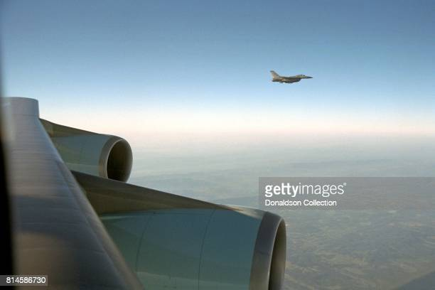An F-16 escorts Air Force One Tuesday, Sept. 11 from Offutt Air Force Base in Nebraska to Andrews Air Force Base. Photo by Eric Draper, Courtesy of...