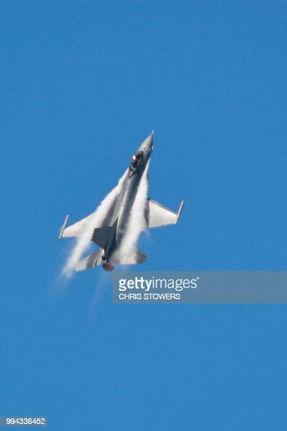 An F16 fighter pulls up in a steep climb during rehearsals for a public airshow at the military airbase in Taitung on July 9 2018