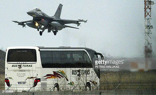 An F16 fighterbomber takes off 29 March 2004 at the Zokniai airfield near Siauliai one of four F16s attached to the Belgian air force which will...