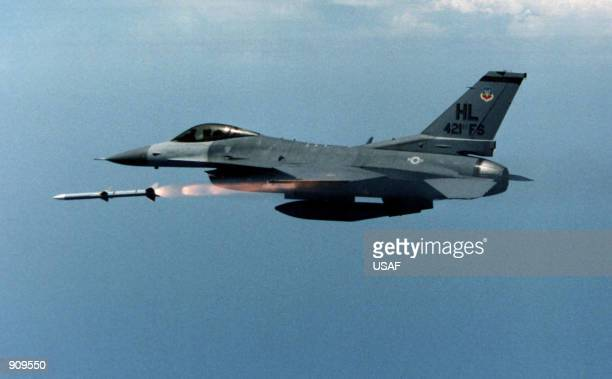 An F16 from 421st Fighter Squadron Hill Air Force Base Utah releases the first AIM120 Advanced Medium Range AirtoAir Missile over reservation land...