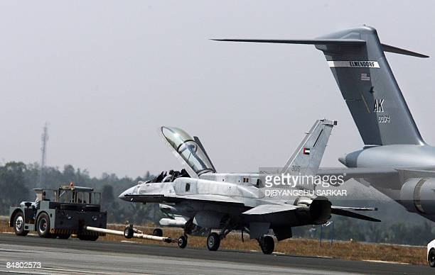 An F16 IN Super Viper which suffred an tyre burst while landing is towed away at the Yelahanka Air Force Station during the final day of the Aero...