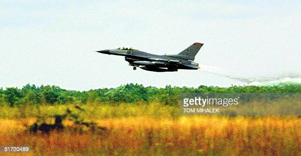 An F-16C Fighting Falcon of the 177th Fighter Wing, New Jersey Air National Guard, takes off on a mission 25 September in Pomona near Atlantic City,...
