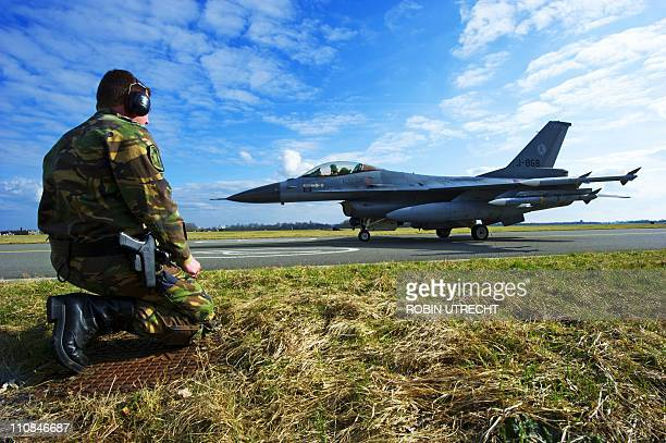 An F16's takes off from Leeuwarden Airbase for the Italian island of Sardinia on March 24 2011 The Netherlands contributed six F16 fighter jets about...