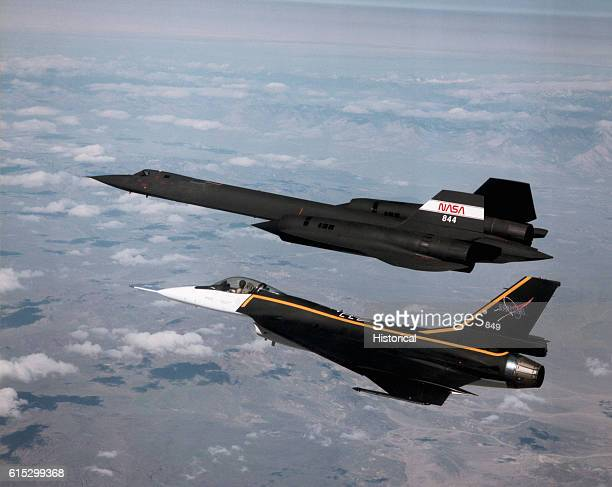 An F16XL fighter plane follows an SR71A reconnaissance aircraft in flight measuring its shockwaves for sonic boom research being conducted by NASA at...