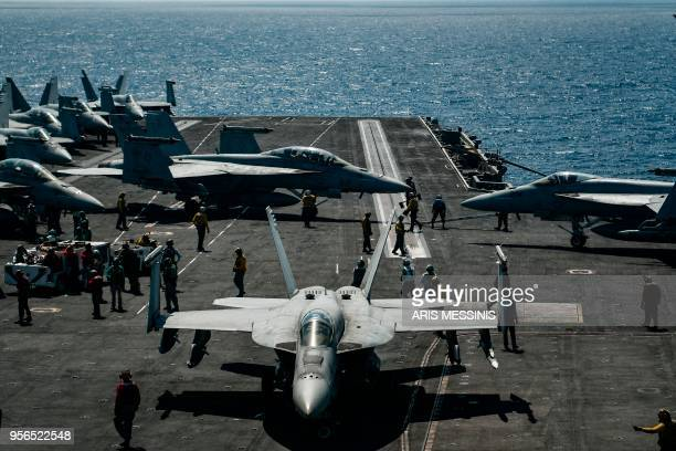An F18 Hornet fighter jet moves on the deck of the 330 meters navy aircraft carrier USS Harry S Truman in the eastern Mediterranean Sea on May 8 2018...