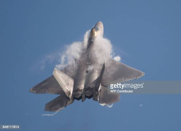 An F22 Raptor does a flyby during the airshow at Joint Andrews Air Base in Maryland on September 16 2017 / AFP PHOTO / Andrew CABALLEROREYNOLDS