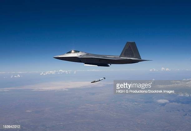 An F-22 Raptor releases a GBU-32 JDAM on a training mission out of Holloman Air Force Base, New Mexico.