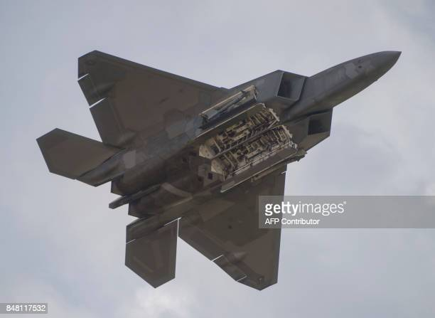 An F22 Raptor shows the internal bays as it does a flyby during the airshow at Joint Andrews Air Base in Maryland on September 16 2017 / AFP PHOTO /...