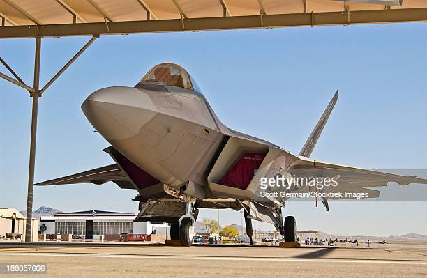 An F-22A Raptor parked at Nellis Air Force Base, Nevada. This is an operational test aircraft used to derive procedures, systems, new techniques and hardware.