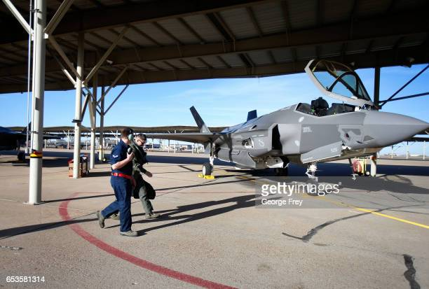 An F35 fighter pilot and ground crew member walk to their plane for a training mission at Hill Air Force Base on March 15 2017 in Ogden Utah Hill is...