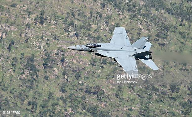 An F/A 18E Super Hornet from the United States Navy fighter squadron VFA115 conducts a flyby after concluding a bombing and strafing run on April 6...