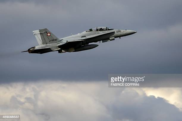 An F/A18 Hornet fighter aircraft of the Swiss Air Force takes off on November 13 2014 from the military airbase of Payerne western Switzerland AFP...