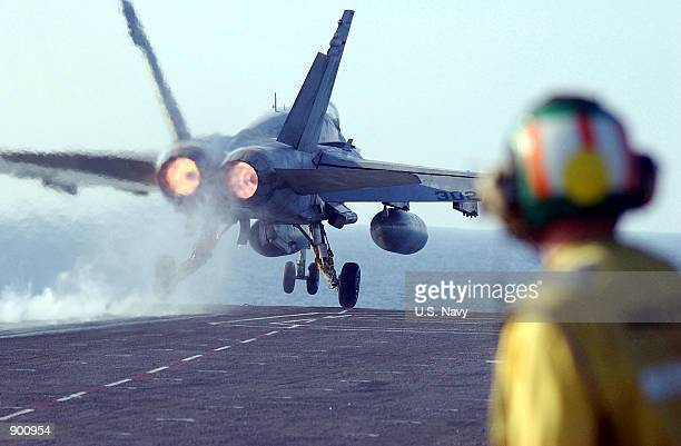 """An F/A-18 """"Hornet"""" from Fighter Attack Squadron 192 """"Golden Dragons,"""" part of Carrier Air Wing 5, launches December 2, 2001 from the flight deck of..."""