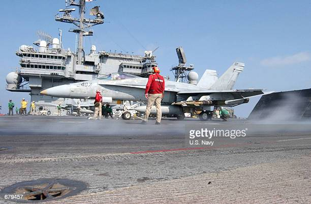 """An F/A-18 """"Hornet"""" from the """"Dambusters"""" of Strike Fighter Squadron One Nine Five is readied for launch November 2, 2001 off the flight deck of the..."""