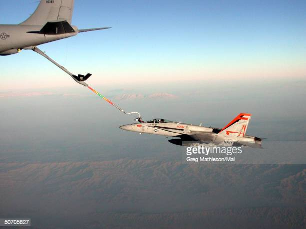 An F/A18 Hornet from the Mighty Shrikes of Strike Fighter Squadron Nine Four receiving fuel from a US Air Force KC135 tanker