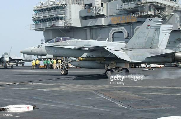 "An F/A-18 ""Hornet"" makes an arrested landing November 21, 2001 on the flight deck of the USS Kitty Hawk. The USS Kitty Hawk operates out of Yokosuka,..."