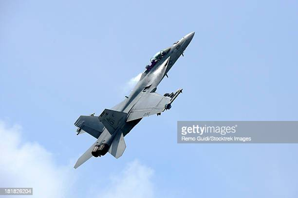 an f/a-18 super hornet of the u.s. navy in flight over langkawi airport, malaysia. - asian hornet stock pictures, royalty-free photos & images