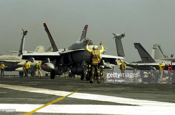 An F/A18C Hornet is prepared for launch from the aircraft carrier USS Carl Vinson October 7 2001 in preparation for strikes against al Qaeda...