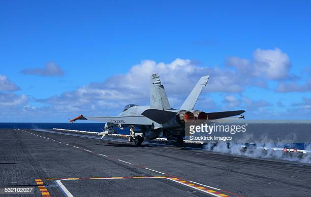 An F/A-18C Hornet launches from aircraft carrier USS Carl Vinson.