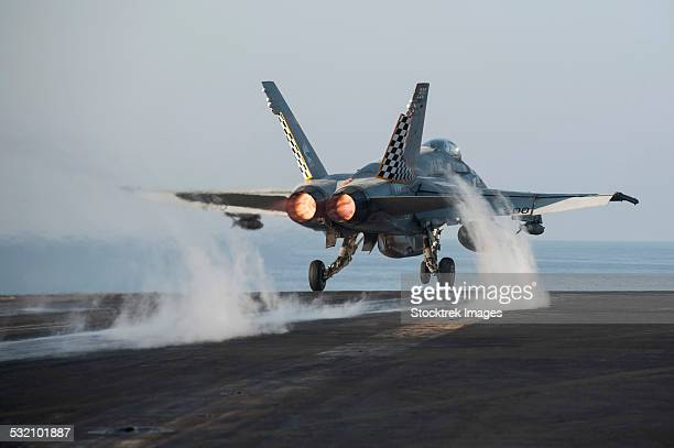 An F/A-18C Hornet launches from USS Harry S. Truman.