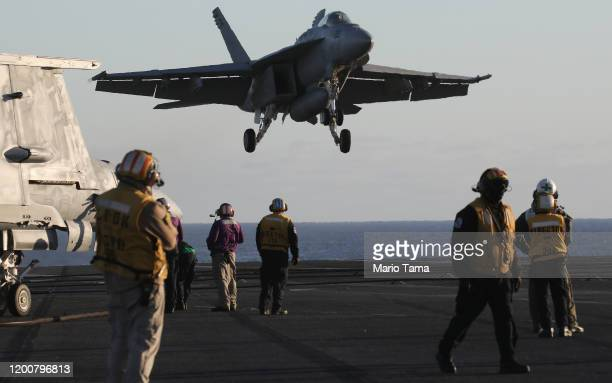 An F/A18E Super Hornet fighter aircraft descends to land on the flight deck of the USS Nimitz aircraft carrier while at sea on January 18 2020 off...