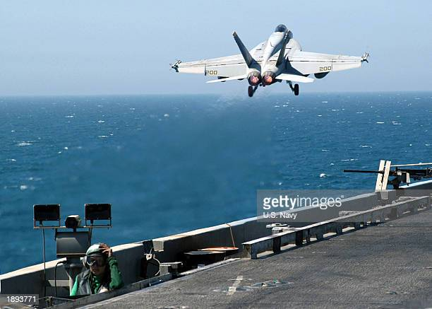 An F/A18E Super Hornet launches from one of four steam powered catapults on the flight deck aboard USS Abraham Lincoln Lincoln and Carrier Air Wing...