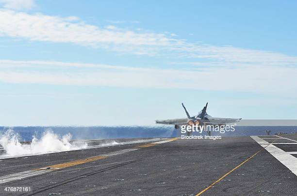An F/A-18E Super Hornet launches from the flight deck of USS George Washington.