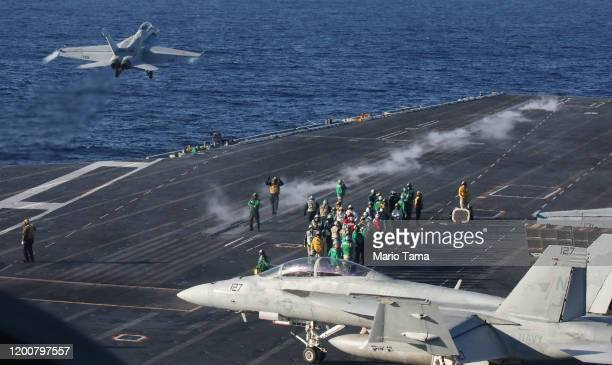 An F/A-18F Super Hornet fighter aircraft takes off from the flight deck of the USS Nimitz aircraft carrier while at sea on January 18, 2020 off the...