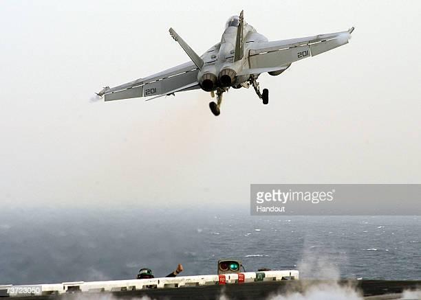 An F/A18F Super Hornet launches from the flight deck of Nimitzclass aircraft carrier USS Dwight D Eisenhower March 27 2007 in the Persian Gulf The...