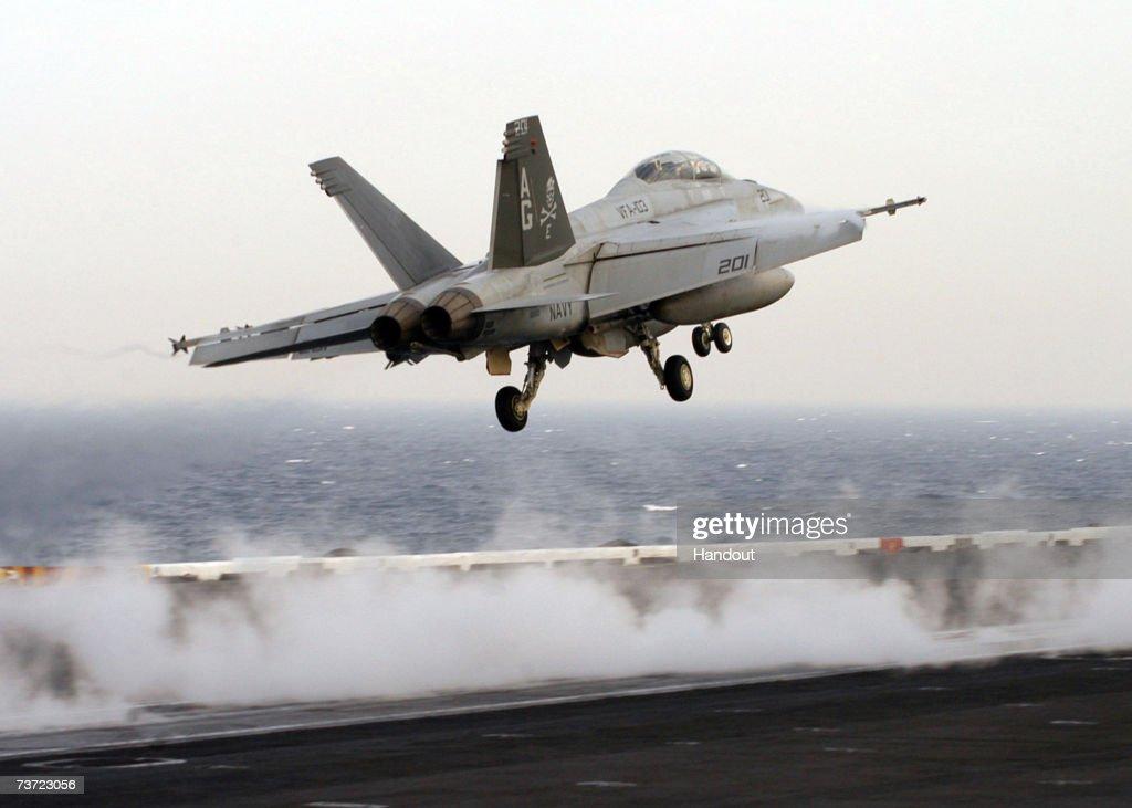 U.S. Navy Flexes Muscles; Iran Warned On Britons : News Photo