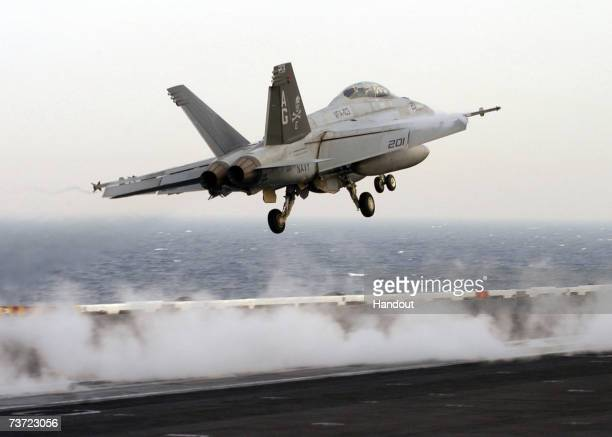 An F/A18F Super Hornet launches from the flight deck of Nimitzclass aircraft carrier USS Dwight D Eisenhower March 27 2007 in the Persian Gulf The...
