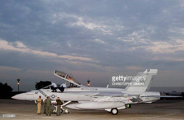 An F/A18F Super Hornet of the Strike Fighter Squadron 102 Diamondbacks arrives at the Atsugi Naval Air Facility from Hawaii 13 November 2003 Four...