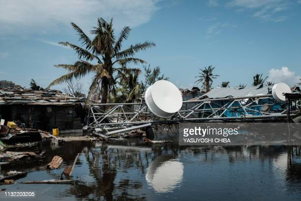 An fallen antenna is seen near the beach in Beira Mozambique on March 23 2019 The death toll in Mozambique on March 23 2019 climbed to 417 after a...