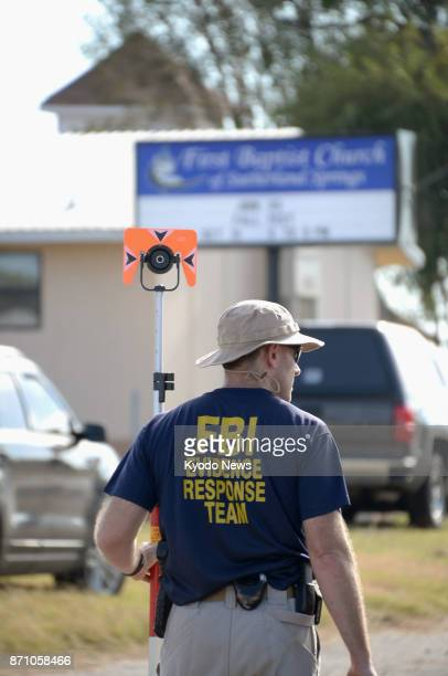 An FBI agent inspects on Nov 6 the church in Sutherland Springs Texas where a gunman shot dead 26 people ==Kyodo