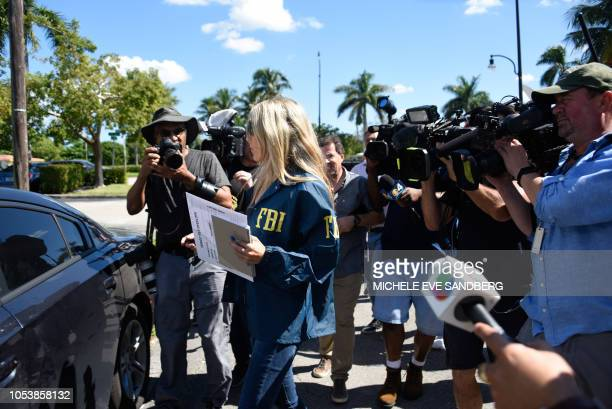 An FBI agent leaves the Auto Zone Store in Plantation North of Miami on October 26 2018 where a suspect was arrested in connection with the 12 pipe...