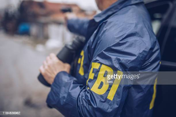 an fbi agent uses a gun in action - fbi stock pictures, royalty-free photos & images