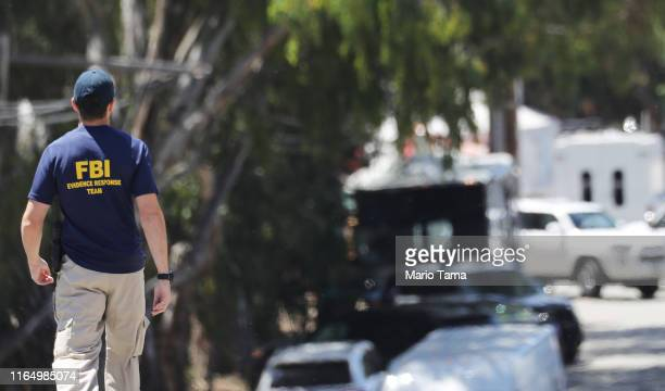 An FBI agent walks toward the site of the Gilroy Garlic Festival after a mass shooting took place there yesterday on July 29, 2019 in Gilroy,...