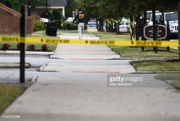 An FBI agent work on June 1 at the scene of the mass shooting in the Virginia Beach Municipal center in Virginia Beach Virginia A municipal employee...
