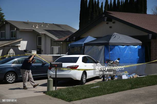 An FBI investigator enters the home of accused rapist and killer Joseph James DeAngelo on April 24 2018 in Citrus Heights California Sacramento...