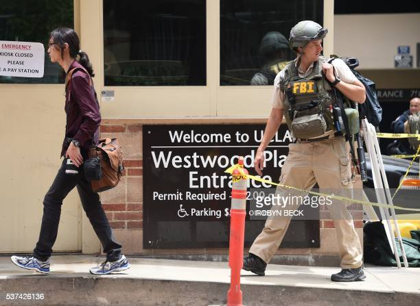 An FBI officer is seen on the University of California Los Angeles after a shooting on campus June 1 in Los Angeles California Two people were...
