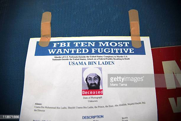 An FBI printout is seen at a makeshift memorial on the fence surrounding the World Trade Center site after the death of accused 9/11 mastermind Osama...
