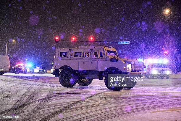 An FBI tactical vehicle leaves the scene of a shooting near a Planned Parenthood clinic where a gunman shot and killed a police officer two civilians...