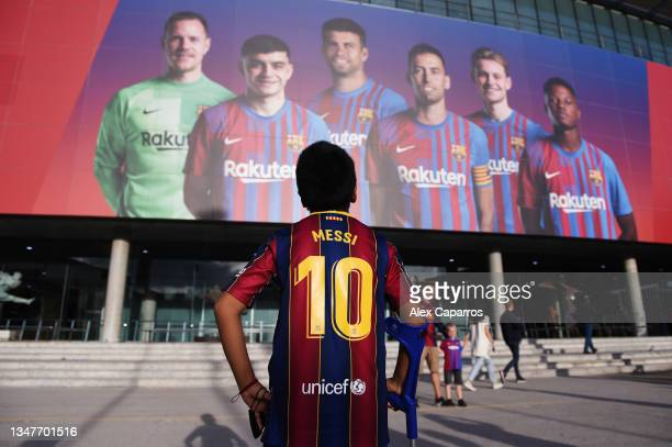 An FC Barcelona fan with a Lionel Messi printed shirt stands outside the stadium prior to the UEFA Champions League group E match between FC...