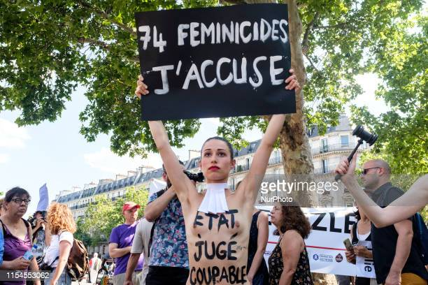 An Femen activist carries a sign with the words quot74 feminicides I accusequot and quotState found guiltyquot on her chest at a rally that gathered...