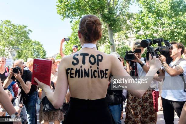 An Femen activist faces the press while behind her back is written quotStop femicidequot during a rally that gathered several hundred people on...